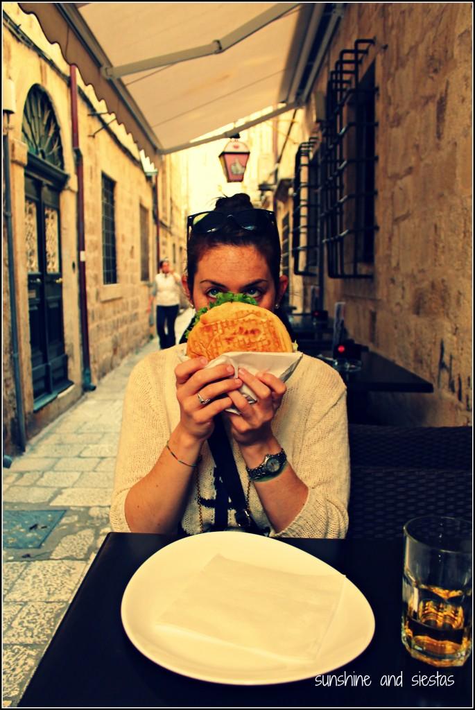 eating cevapi sandwich balkans
